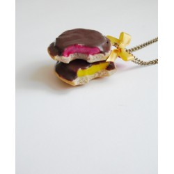 Collier biscuit génoise coque chocolat fourré orange ou framboise