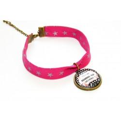 """Bracelet rose étoiles argentées avec un cabochon """" Tu es une nounou qui déchire! """""""